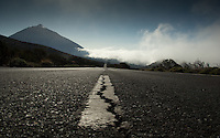 Road in the mist Mount Teide in the background.Parque nacional de las Cañadas,Tenerife, Canary Islands, Spain