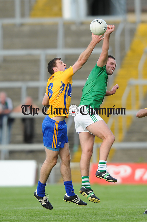 Gary Brennan of Clare in action against Thomas Lee of Limerick during their  Senior championship semi-final at the Gaelic Grounds. Photograph by John Kelly.