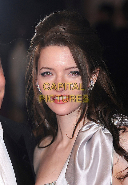 TALULAH RILEY .2011 Orange British Academy Film Awards (Baftas) at The Royal Opera House, London, England, UK,.February 13th, 2011..arrivals portrait headshot  one shoulder white cream satin silk bow .CAP/BEL.©Tom Belcher/Capital Pictures.