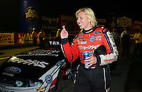 Sept. 1, 2012; Claremont, IN, USA: NHRA funny car driver Courtney Force reacts after qualifying number one during qualifying for the US Nationals at Lucas Oil Raceway. Mandatory Credit: Mark J. Rebilas-