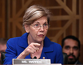 """United States Senator Elizabeth Warren (Democrat of Massachusetts) questions Richard F. Smith, former Chairman and Chief Executive Officer, Equifax, Inc. as he gives testimony before the United States Senate Committee on Banking, Housing, and Urban Affairs as they conduct a hearing entitled, """"An Examination of the Equifax Cybersecurity Breach"""" on Capitol Hill in Washington, DC on Tuesday, October 3, 2017. <br /> Credit: Ron Sachs / CNP"""
