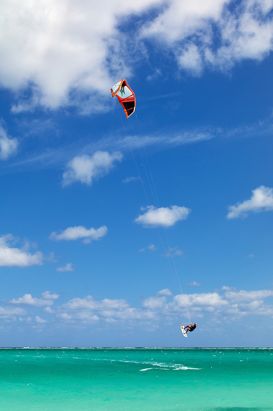 Man kitesurfing,or kiteboarding at Grace Bay. Providenciales. Turks and Caicos