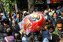 March 3, 2012, Tokyo, Japan - A man brought up a Daruma doll, a Japanese traditional ornament of Buddhism, as he moved through a crowded area at Daruma Ichi, or Daruma Market, at Jindaiji Temple in Chofu, Tokyo, Japan on March 3, 2012. This was one of the biggest three Daruma Markets in Japan. Since it was taken place on March 3 and 4 every year no matter what day of the week and was weekend this year, many people showed up. (Photo by Koichiro Suzuki/AFLO) [4012]