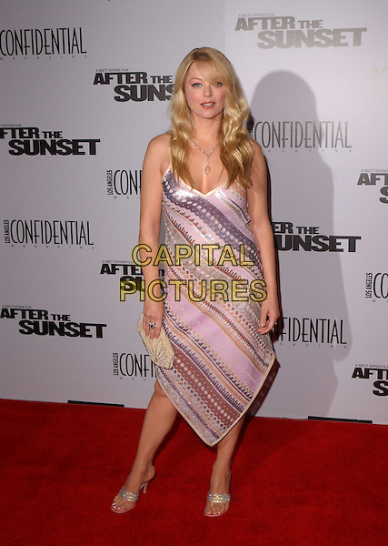 "CHARLOTTE ROSS.The New Line Cinema's L.A. Premiere of ""After the Sunset"" held at The Mann's Chinese Theatre in Hollywood, California .November 4, 2004.full length, purple striped dress.www.capitalpictures.com.sales@capitalpictures.com.© Capital Pictures."