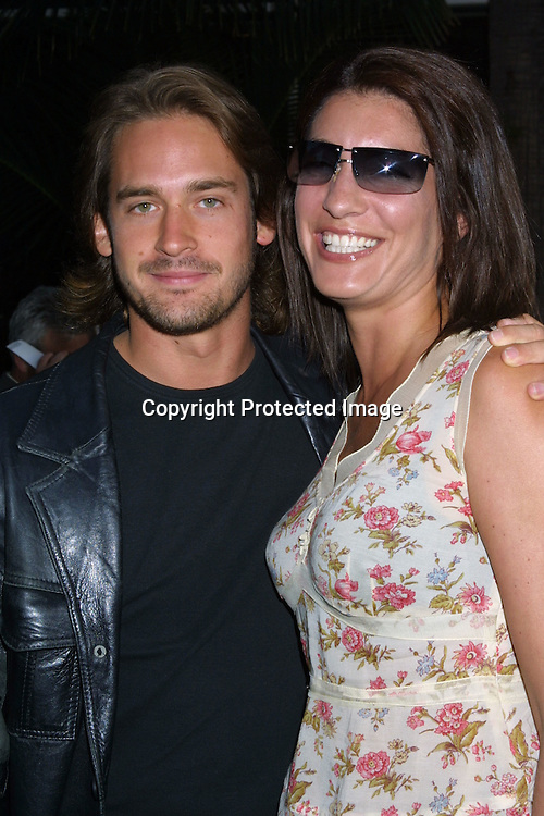 "@2003 KATHY HUTCHINS / HUTCHINS PHOTO AGENCY.""The Hulk"" Premiere.UNIVERSAL AMPITHEATER.UNIVERSAL CITY, CA.JUNE 17 , 2003..WILLIAM KEMP AND WIFE"