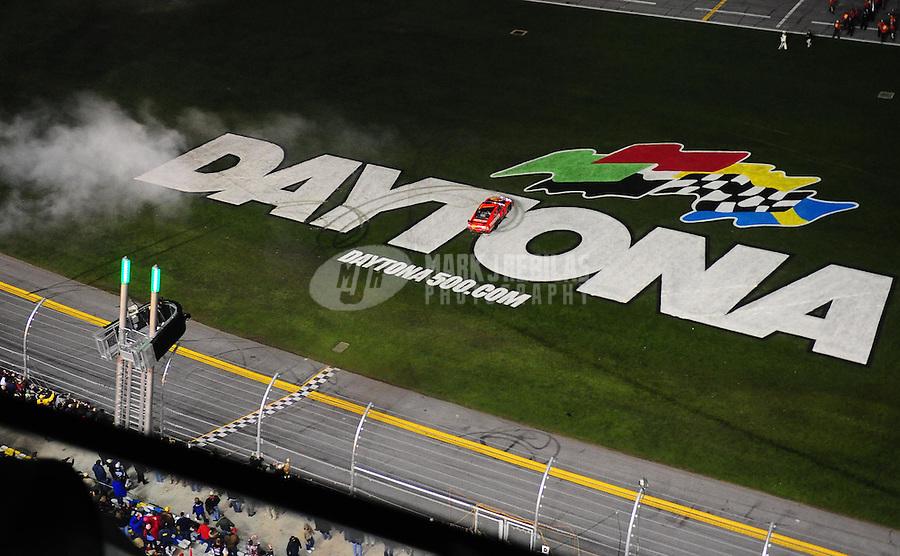 Feb 14, 2010; Daytona Beach, FL, USA; NASCAR Sprint Cup Series driver Jamie McMurray celebrates after winning the Daytona 500 at Daytona International Speedway. Mandatory Credit: Mark J. Rebilas-