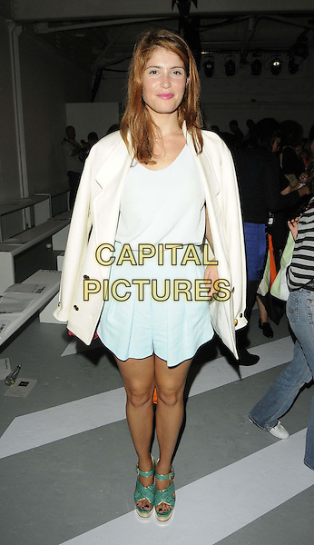 Gemma Arterton.attended the Holly Fulton s/s 2013 catwalk show, LFW Day 2, Mercer Street Studios, Mercer St., London, England, 15th September 2012..full length cream coat jacket white  top green skirt shorts sandals snakeskin turquoise shoes .CAP/CAN.©Can Nguyen/Capital Pictures.