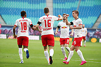 27th May 2020, Red Bull Arena, Leipzig, Germany; Bundesliga football, RB Leipzig versus Hertha Berlin;   Lukas Klostermann (16, RB Leipzig) celebrates his goal to equalise at 1:1 with Christopher Nkunku (18, RB Leipzig) and Dani Olmo (25, RB Leipzig).