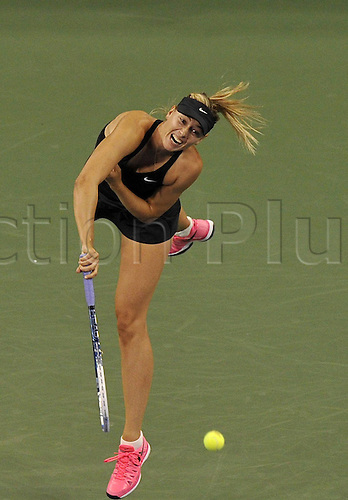 25.08.2014. Flushing Meadows, NY, USA.  Maria Sharapova of Russia competes during for women s singles 1st round match against her compatriot Maria Kirilenko at the U.S. Open tennis tournament in New York, the United States, on Aug. 25, 2014. Maria Sharapova won 2-0.