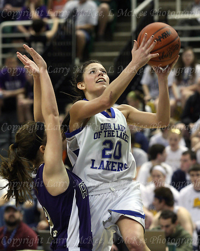 Ava Doetsch, Waterford Our Lady of the Lakes, goes up for a shot over an Athens defender during Class D state championship action at the Breslin Center in Lansing Saturday, March 17, 2012.