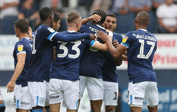 Huddersfield Town's Karlan Grant celebrates scoring his side's first goal with his team mates<br /> <br /> Photographer Rob Newell/CameraSport<br /> <br /> The EFL Sky Bet Championship - Luton Town v Huddersfield Town - Saturday 31 August 2019 - Kenilworth Stadium - Luton<br /> <br /> World Copyright © 2019 CameraSport. All rights reserved. 43 Linden Ave. Countesthorpe. Leicester. England. LE8 5PG - Tel: +44 (0) 116 277 4147 - admin@camerasport.com - www.camerasport.com