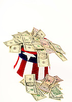 Hat made of the American flag with money falling out