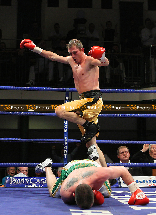 Lenny Daws (yellow shorts) defeats Barry Morrison in a Light-Welterweight boxing contest for the British Title at York Hall, Bethnal Green, promoted by Matchroom Sports / Barry Hearn - 18/09/09 - MANDATORY CREDIT: Gavin Ellis/TGSPHOTO - Self billing applies where appropriate - Tel: 0845 094 6026