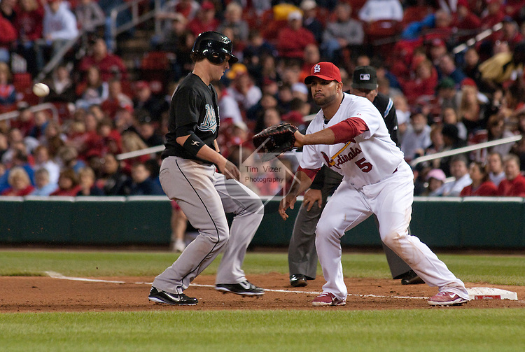 04 May 2011                              Florida Marlins center fielder Chris Coghlan (8) hustles back to first base to avoid the pickoff throw to St. Louis Cardinals first baseman Albert Pujols (5).  The St. Louis Cardinals hosted the Florida Marlins on Wednesday May 4, 2011 in the third game of a four-game series at Busch Stadium in downtown St. Louis.