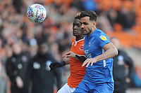 Blackpool's Armand Gnanduillet vies for possession with Peterborough United's Ryan Tafazolli<br /> <br /> Photographer Kevin Barnes/CameraSport<br /> <br /> The EFL Sky Bet League One - Blackpool v Peterborough United - Saturday 13th April 2019 - Bloomfield Road - Blackpool<br /> <br /> World Copyright &copy; 2019 CameraSport. All rights reserved. 43 Linden Ave. Countesthorpe. Leicester. England. LE8 5PG - Tel: +44 (0) 116 277 4147 - admin@camerasport.com - www.camerasport.com