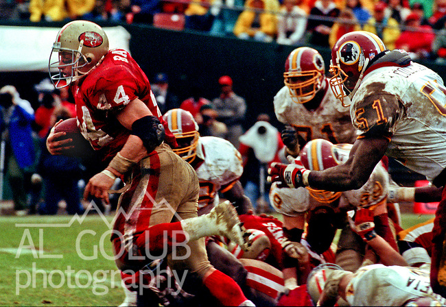 San Francisco 49ers vs. Washington Redskins at Candlestick Park Saturday, January 9,1993.  49ers Beat Redskins 20-13.  San Francisco 49ers running back Tom Rathman (44) pulls away from defenders.
