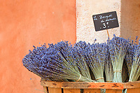 A basket of lavender bundled in bouquets for sale.  Taken in Roussillon, France, known for their ochre pigments found in the town quarry.