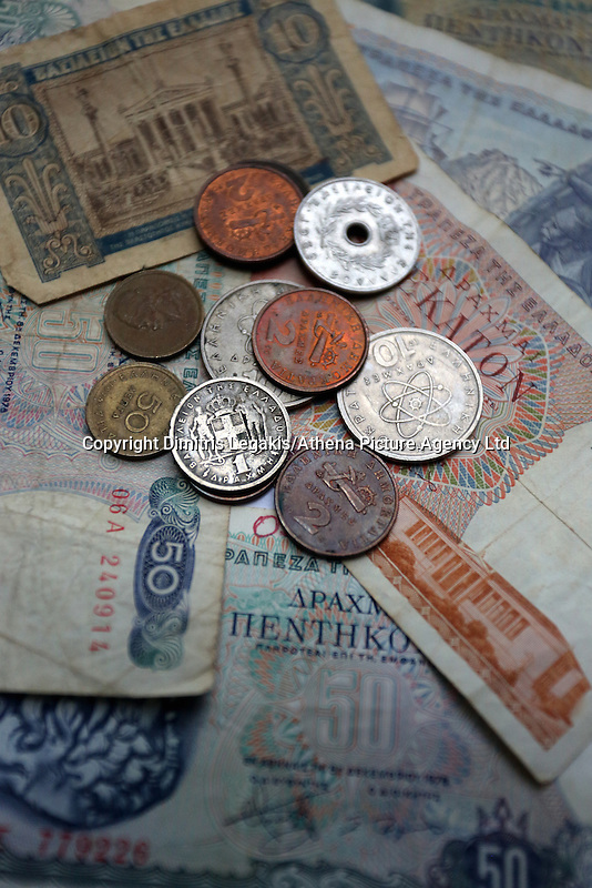 A mixture of old drachma coins and paper notes