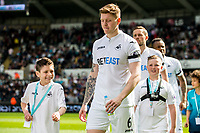 Sunday April 02 2017 <br /> Pictured: Players and mascots <br /> Re: Premier League match between Swansea City and Middlesbrough at The Liberty Stadium, Swansea, Wales, UK. SUnday 02 April 2017