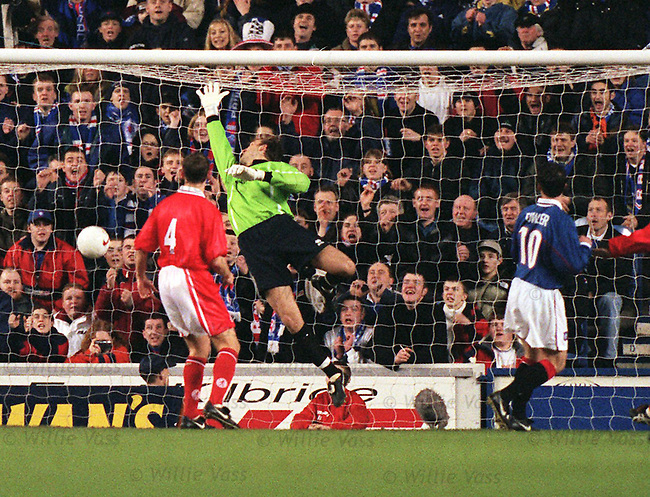 Robbie Fowler scores for Rangers at Ibrox during Alan McLaren's testimonial match with Middlesboro