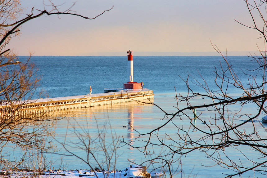 A wintery view of the lighthouse pier in Oakville, Ontario