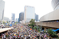 Thousands of Saints fans wearing dresses paraded from the Louisiana Superdome to the French Quarter on January 31, 2010 in New Orleans to honor a promise made by the late sportscaster and Saints super-fan Buddy Diliberto aka &quot;Buddy D&quot;.<br /> <br /> In 1993 Buddy D, who passed away in 2005, remarked on air that if the Saints were to make it to the Super Bowl, he would wear a dress and dance down the streets.  The comment was repeated at various times and never forgotten by his listeners.<br /> <br /> Led by former New Orleans Saints quarterback Bobby Hebert, who has taken Buddy D's place on WWL radio, thousands made good on his promise for him, dancing, drinking, and cavorting their way down the street, alternately yelling out &quot;Who Dat!&quot; and &quot;Buddy D!&quot; in front of an onlooking crowd an estimated 85,000 people strong.<br /> <br /> The hard luck NFL team the New Orleans Saints has reached its first Super Bowl in team history, after 43 years largely filled with losing seasons and futility.  It is difficult to travel anywhere in the area without some reminder of this fact, as the team and city are intertwined perhaps like no other sports franchise in this country.