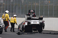 Feb 9, 2014; Pomona, CA, USA; The Safety Safari comes to help NHRA funny car driver Cruz Pedregon after having a blower explosion during the Winternationals at Auto Club Raceway at Pomona. Mandatory Credit: Mark J. Rebilas-