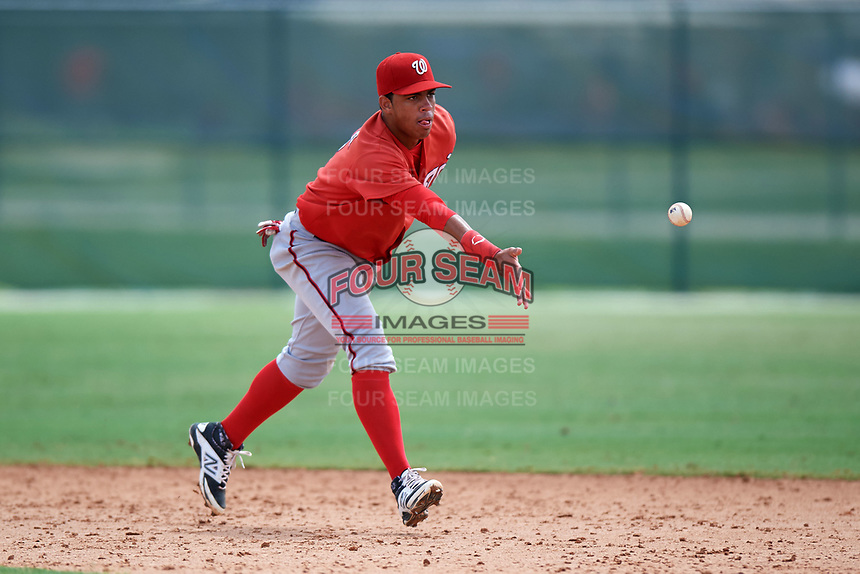 GCL Nationals shortstop Luis Garcia (7) flips the ball to second base during the first game of a doubleheader against the GCL Marlins on July 23, 2017 at Roger Dean Stadium Complex in Jupiter, Florida.  GCL Nationals defeated the GCL Marlins 4-0.  (Mike Janes/Four Seam Images)