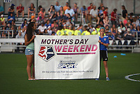 Kansas City, MO - Saturday May 07, 2016: Kids hold a sign for Mother's Day Weekend before the game between Houston Dash and FC Kansas City during a regular season National Women's Soccer League (NWSL) match at Swope Soccer Village. Houston won 2-1.