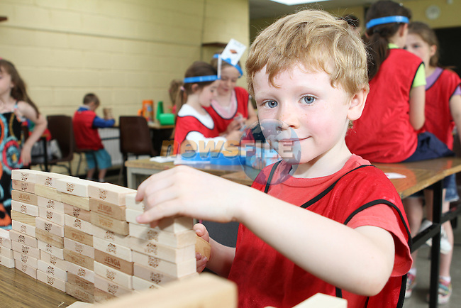 Rian has fun building at the Greenhills Summer Camp...(Photo credit should read Jenny Matthews www.newsfile.ie)....This Picture has been sent you under the conditions enclosed by:.Newsfile Ltd..The Studio,.Millmount Abbey,.Drogheda,.Co Meath..Ireland..Tel: +353(0)41-9871240.Fax: +353(0)41-9871260.GSM: +353(0)86-2500958.email: pictures@newsfile.ie.www.newsfile.ie.