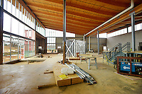 STAFF PHOTO BEN GOFF  @NWABenGoff -- 12/12/14 Laminate wood beams and large South-facing windows highlight the main gallery space inside the Amazeum under construction in Bentonville on Friday Dec. 12, 2014.