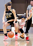 WOLCOTT CT. 10 December 2018-121018SV11-#22 Adra Bojka of Woodland High and #1 Emiah Soto of Wolcott High battle for the loose ball during 1st quarter NVL basketball action in Wolcott Monday.<br /> Steven Valenti Republican-American