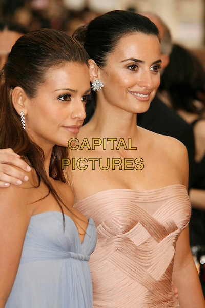 MONICA CRUZ & PENELOPE CRUZ.The 79th Annual Academy Awards - Arrivals held at the Kodak Theatre, Hollywood, California, USA,.February 25th, 2007..oscars red carpet half length pink strapless dress Versace gown blue sisters siblings family.CAP/ADM/RE.©Russ Elliot/AdMedia/Capital Pictures...