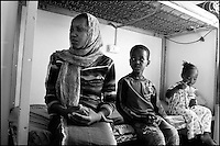 Z. A. and her children are seen in their room at Ktziot prison, August 21, 2007.Sudanese refugees who crossed into Israel illegally are seen in Ktiziot Prison in the Negev Dessert in Israel. About 130 women and children are living in the prison and their future is unclear. Israel said on Sunday it would turn away refugees from Sudan enforcing a policy aimed at halting illegal African migration via Egypt. Photo by Quique Kierszenbaum
