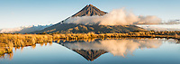 Sunset over Taranaki, Mt. Egmont with reflections in alpine tarn, Egmont National Park, North Island, New Zealand, NZ