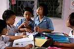 Girls at the Vieng Ping orphanage dispute the answer to their homework.<br /> <br /> Children without their parents are more vulnerable to abuse, including trafficking for sexual exploitation. This is why institutions such as the Viang Ping and the work of UNICEF are so critical in Northern Thailand.<br /> <br /> In May 2007, Qantas staff from the Change for Good programme visited UNICEF in northern Thailand to see how money they have raised is helping children.