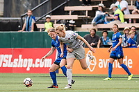Seattle, WA - Sunday, August 13, 2017: Kristen McNabb and Samantha Mewis during a regular season National Women's Soccer League (NWSL) match between the Seattle Reign FC and the North Carolina Courage at Memorial Stadium.