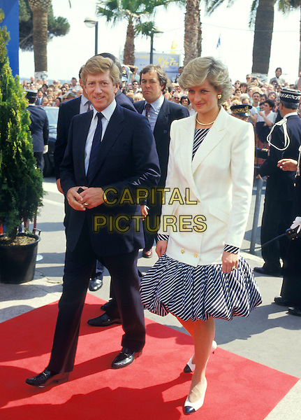 HRH PRINCE CHARLES &  THE PRINCESS DIANA OF WALES.Cannes Film Festival, France, 15 May 1987..Lady Di family her royal highness full length white jacket blue and white striped dress puff ball skirt two tone bi colour shoes pumps Chanel style.Ref: CAP/PL.Ref: CAP/PL.©Phil Loftus/Capital Pictures