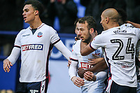Bolton Wanderers' Adam Le Fondre celebrates scoring his side's first goal with team mates Antonee Robinson and Karl Henry <br /> <br /> Photographer Andrew Kearns/CameraSport<br /> <br /> The EFL Sky Bet Championship - Bolton Wanderers v Fulham - Saturday 10th February 2018 - Macron Stadium - Bolton<br /> <br /> World Copyright &copy; 2018 CameraSport. All rights reserved. 43 Linden Ave. Countesthorpe. Leicester. England. LE8 5PG - Tel: +44 (0) 116 277 4147 - admin@camerasport.com - www.camerasport.com