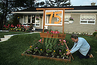 Ile D'Orleans, Quebec City Area, Canada, June 8, 1984. Gardening in front of the house.