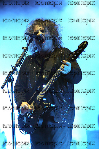 THE CURE - vocalist guitarist Robert Smith performing on Day One as the band headline the Main Stage at the Reading Festival 2012 in Richfield Avenue Reading UK - 24 Aug 2012.  Photo credit: Dean Fardell/IconicPix