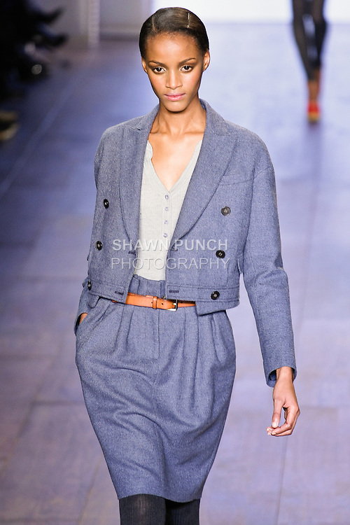 Sedene Blake walks Tommy Hilfiger Fall 2010 Preppy With A Pop runway show in a slate blue wool hopsack skirt suit,  and heather grey cashmere ribbed henley, during the Mercedez-Benz Fashion Week.