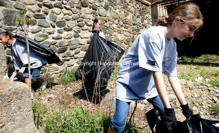 PLYMOUTH, CT- 04 MAY 07- 050507JT01-<br /> From right, Bethany Russo, Kathryn McAdoo, and Dacey Santaniello pick up trash near the Lock Museum on Main Street in Plymouth on Saturday as part of the Beautification Committee's second annual sping clean up of Main Street.<br /> Josalee Thrift Republican-American