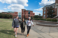 Students walking on sidewalk in front of Swalm.<br />  (photo by Megan Bean / &copy; Mississippi State University)