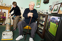Young carers looking after elderly relatives.  Photo posed by models.  Model released...Young boy hoovers for his grandfather/ elderly relative...Following info from http://www.barnardos.org.uk :  .With so many adult responsibilities, young carers often miss out on opportunities that other children have to play and learn. Many struggle educationally and are often bullied for being 'odd'. They can become isolated, with no relief from the pressures at home, and no chance to enjoy a normal childhood. They are afraid to ask for help as they fear letting the family down or being taken into care..Facts and figures.othe average age of a young carer is 12..othe 2001 census shows that there are 175,000 young carers in the UK, 13,000 of whom care for more than 50 hours a week..omore than half of young carers live in one-parent families and almost a third care for someone with mental health problems.