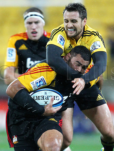 17.03.2013 Wellington, New Zealand. Hurricanes' Tim Bateman makes a tackle on Chiefs' Ben Afeaki during the 2013 Super Rugby season - Hurricanes v Chiefs, Westpac Stadium...