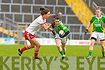 Sarah Houlihan goes past Tyrone's Laura Kilpatrick in Fitzgerald Stadium on Sunday during their NFL division 1 clash