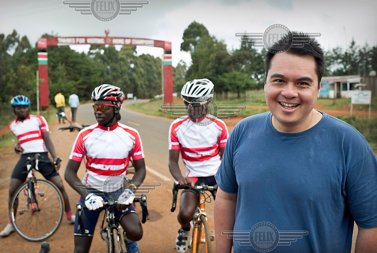 The Kenyan National Cycling Team as they train along a road between Eldoret and Iten. The team is managed by Singaporian Nicholas Leong (pictured) and trained by Australian Simon Blake.