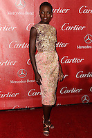 PALM SPRINGS, CA - JANUARY 04: Actress Lupita Nyong'o wearing a Elie Saab hue rose gold dress arrives at the 25th Annual Palm Springs International Film Festival Awards Gala held at Palm Springs Convention Center on January 4, 2014 in Palm Springs, California. (Photo by Xavier Collin/Celebrity Monitor)