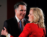 Ann Romney embraces Mitt Romney after introducing him at a rally following the Iowa caucus Tuesday, January 3, 2012 in Des Moines, Iowa.  (Christopher Gannon/GannonVisuals.com/MCT)